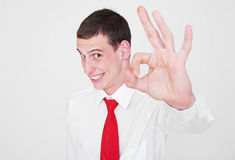 Cheerful businessman showing ok sign Royalty Free Stock Image