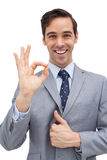 Cheerful businessman showing ok sign Royalty Free Stock Images