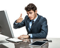 Cheerful businessman showing thumbs up success sign Stock Photos