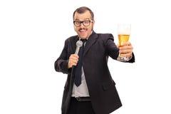 Cheerful businessman singing karaoke Royalty Free Stock Photography