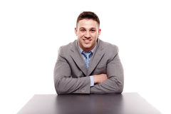 Cheerful businessman sitting with arms folded Stock Photo