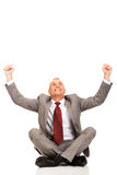 Cheerful businessman sitting cross-legged Royalty Free Stock Images