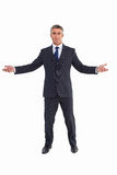 Cheerful businessman spreading his arms Stock Photography