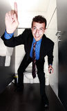 Cheerful businessman standing in restroom Stock Images