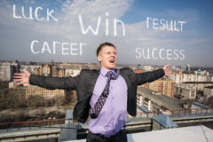 Cheerful businessman standing on the roof Stock Photography
