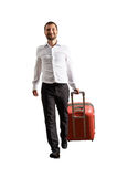 Cheerful businessman with suitcase Stock Photos