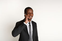 Cheerful businessman talking on mobile phone Stock Images