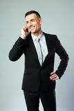 Cheerful businessman talking on the phone Stock Image