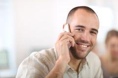 Cheerful businessman talking on phone Royalty Free Stock Photo