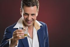 Cheerful businessman toasting Royalty Free Stock Photo