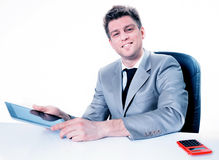 Cheerful businessman using his digital tablet Royalty Free Stock Image