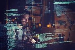 Cheerful businessman using laptop at night. 3D Cheerful businessman using laptop at night in office Royalty Free Stock Photos