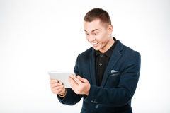 Cheerful businessman using tablet computer Royalty Free Stock Photography