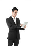 Cheerful businessman using a tablet Royalty Free Stock Images