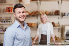 Cheerful businessman wants to buy sweet cake Stock Images