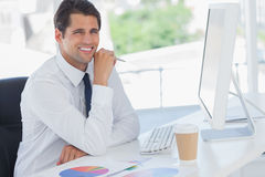 Cheerful businessman working on his computer Royalty Free Stock Photos