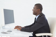 Cheerful businessman working at his desk Stock Image