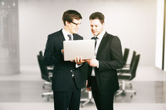 Cheerful businessmen with laptop Royalty Free Stock Images