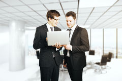 Cheerful businessmen with laptop Stock Photos
