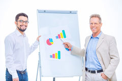 Cheerful businessmen working with charts Stock Photography