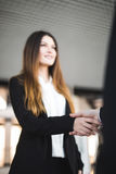 Cheerful businesspeople, or businesswoman and client handshaking Stock Images