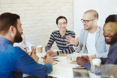 Cheerful businesspeople having project discussion Royalty Free Stock Images