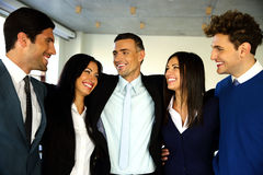 Cheerful businesspeople standing in office Royalty Free Stock Photo
