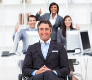 Cheerful businesspeople with thumbs up Royalty Free Stock Images