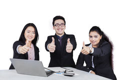 Cheerful businesspeople with thumbs-up isolated Stock Photos