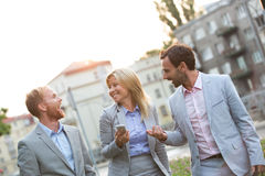 Cheerful businesspeople walking in city Stock Images