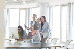 Cheerful businesspeople working together at conference table Royalty Free Stock Photo