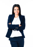Cheerful businesswoman with arms folded Stock Image