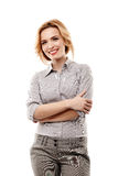 Cheerful businesswoman with arms folded Stock Photography