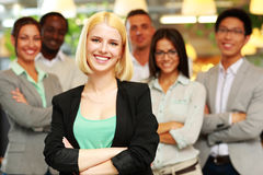 Cheerful businesswoman with arms folded Royalty Free Stock Images