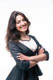 Cheerful businesswoman with arms folded Royalty Free Stock Image