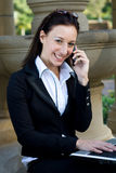 Cheerful businesswoman on cell Stock Images