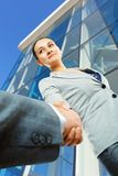 Cheerful businesswoman  and client handshaking Royalty Free Stock Photo
