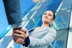 Cheerful businesswoman  and client handshaking Royalty Free Stock Image