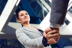 Cheerful businesswoman  and client handshaking Royalty Free Stock Photos