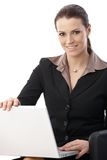 Cheerful businesswoman with computer Stock Photo