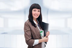 Cheerful businesswoman with document folder. Stock Photos