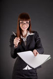 Cheerful businesswoman with documents and pen Stock Photos