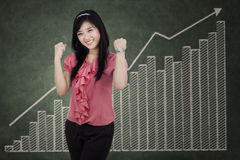 Cheerful businesswoman expressing success Stock Photography
