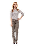 Cheerful businesswoman with hand on hip. Full length portrait of successful businesswoman with hand on hip smiling, isolated on white background Royalty Free Stock Photos