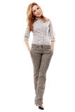 Cheerful businesswoman with hands in pockets Royalty Free Stock Images