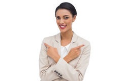 Cheerful businesswoman with her arms crossed and fingers pointin Royalty Free Stock Image