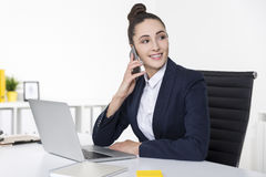 Cheerful businesswoman is on her cell phone Royalty Free Stock Images