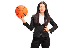 Cheerful businesswoman holding a basketball Royalty Free Stock Photography