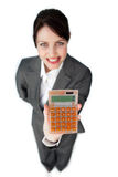 Cheerful businesswoman holding a calculator Stock Image