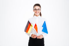 Cheerful businesswoman holding flags of Poland, Germany and European Union Royalty Free Stock Photography